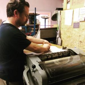 Aaron McNally printing at Caveworks Press